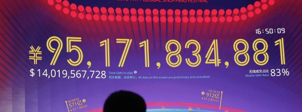 """A giant screen showing a total sales transacted of e-commerce giant Alibaba, on the """"Singles' Day"""" global online shopping festival in Shenzhen, southern China's Guangdong province Friday, Nov. 11, 2016. In a bright spot for China's cooling economy, online shoppers spent billions of dollars Friday on """"Singles Day,"""" a quirky holiday that has grown into the world's busiest day for e-commerce. (AP Photo/Kin Cheung)"""